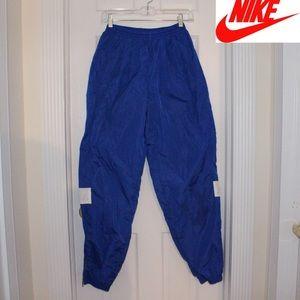 NWOT Mens NIKE Track Pants Blue Nylon Swoosh Logo